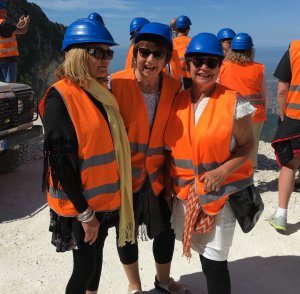travels in carraa posing with hard hats
