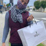 a customer poses with her marketplace meal bag